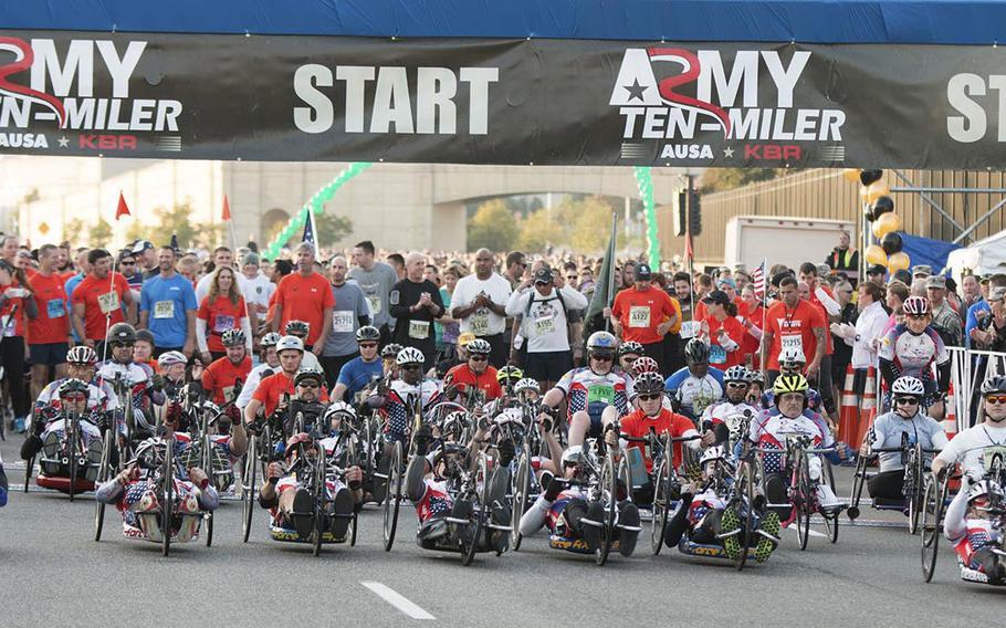 Army Ten-Miler hand cyclist start their trek towards the finish line, October 12, 2014.