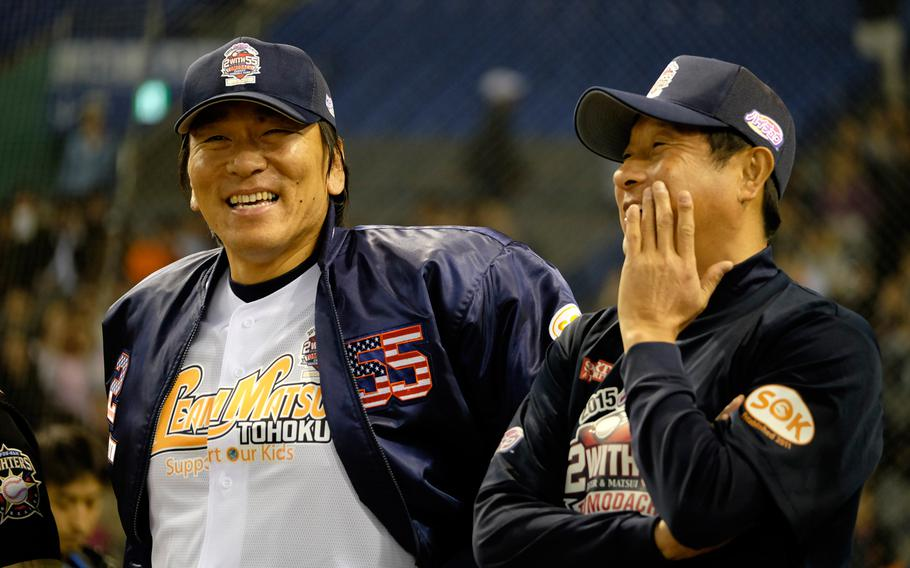 Former New York Yankees pitcher and Yomiuri Giant Hideki Matsui, left, led a team of 14- to 16-year-old baseball players in a charity baseball exhibition game between Japan and the U.S. on Saturday, March 21, 2015, at the Tokyo Dome. The game raised money for victims of the 2011 tsunami and earthquake in northern Japan.