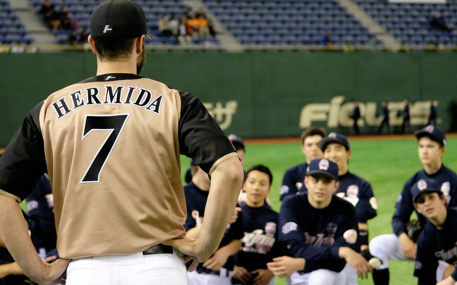 Jeremy Hermida of the Nippon Ham Fighters talks to DODDS and international school players making up Team Jeter on Saturday, March 21, 2015, at the Tokyo Dome. Hermida, a former Major League Baseball player, was the 3rd base coach for Team Jeter.