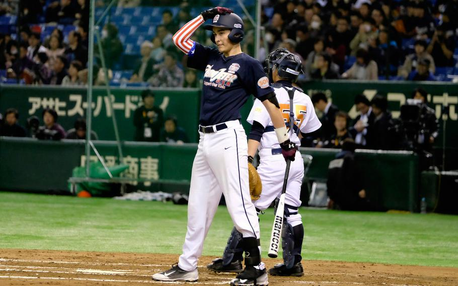 Garrett Macias, a freshman catcher from M.C. Perry High School in Iwakuni, prepares for his at-bat during the '2 with 55 Tomodachi Game' at the Tokyo Dome Saturday, March 21, 2015. The 3-inning charity game raised funds for victims of the 2011 earthquake and tsunami in northern Japan.
