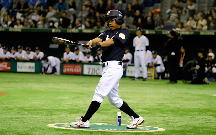 DeShon Morris of Nile C. Kinnick High School in Yokosuka warms up while on deck during the '2 with 55 Tomodachi Game' at the Tokyo Dome Saturday, March 21, 2015. The 3-inning charity game raised funds for victims of the 2011 earthquake and tsunami in northern Japan.