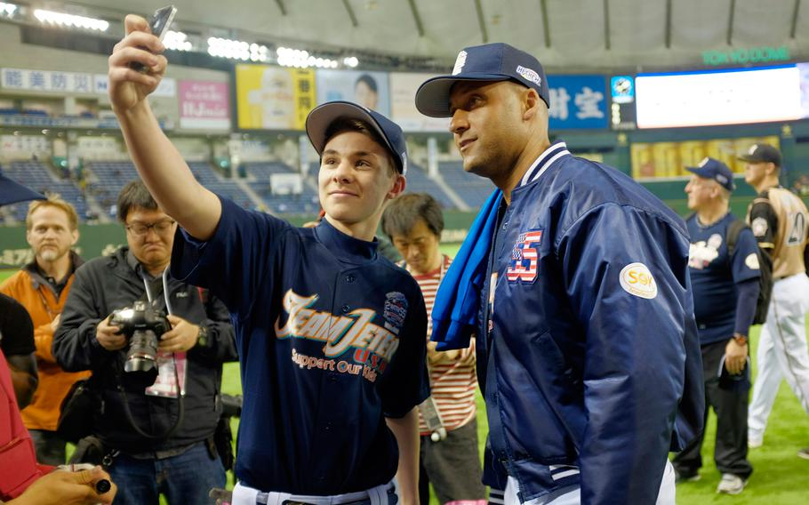 Tanner Dodd of Nile C. Kinnick High School in Yokosuka takes a 'selfie' with former New York Yankees shortstop Derek Jeter on Saturday, March 21, 2015, at the Tokyo Dome.