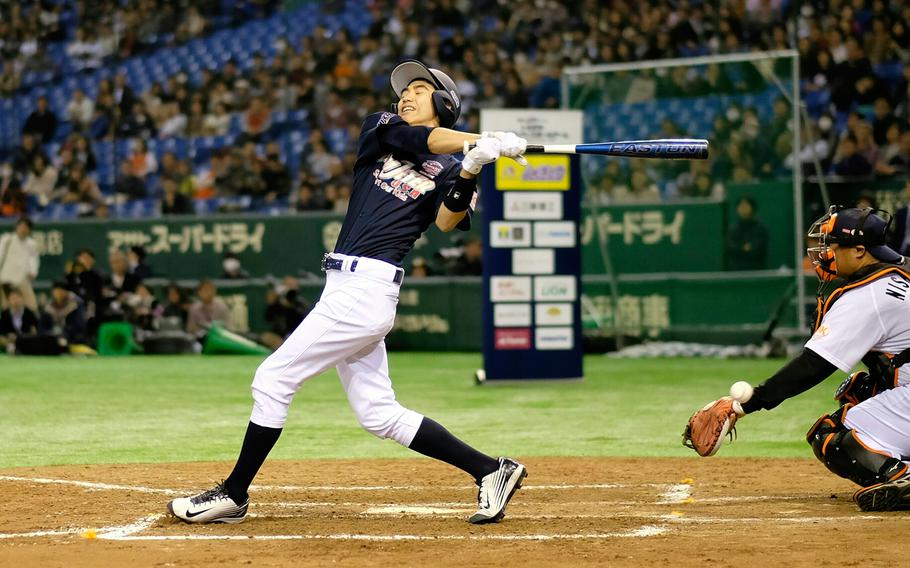 Leo Yang of American School in Japan foul tips during the home run derby portion of the '2 with 55 Tomodachi Game' at the Tokyo Dome Saturday, March 21, 2015. The 3-inning charity game that included high school baseball players, managed by Derek Jeter and Hideki Matsui, from DODDS and international schools raised funds for victims of the 2011 earthquake and tsunami in northern Japan.