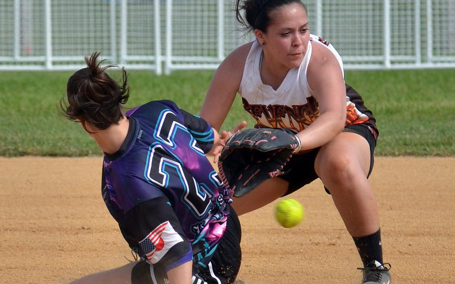 Okinawa Dragons base runner Megan Eliz slides in safely at second just ahead of a throw to Revenge shortstop Danielle Powdrill during Saturday's women's championship game of the Firecracker Shootout Softball Tournament. Dragons won their third straight title 4-3.