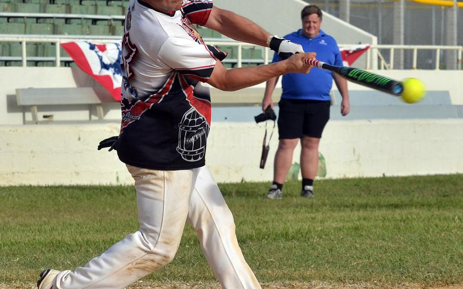 """Pour House's Ben Sanchez makes contact against American Legion during Saturday's Game 1 of a two-game men's final in the Firecracker Shootout Softball Tournament. Legion won 9-4, forcing a second """"if necessary"""" game, which Pour House won 13-12 for its second Firecracker title in three years."""
