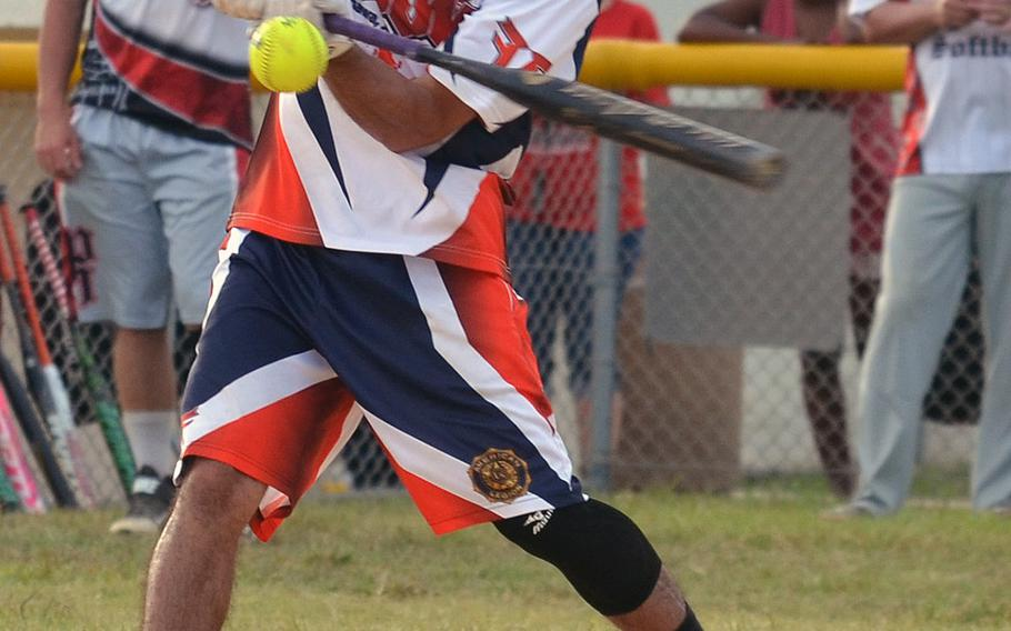 """American Legion's Erik Perez connects against Pour House during Saturday's Game 1 of a two-game men's final in the Firecracker Shootout Softball Tournament. Legion scored five seventh-inning runs and won 9-4, forcing a second """"if necessary"""" game, which Pour House won 13-12 for its second Firecracker title in three years."""