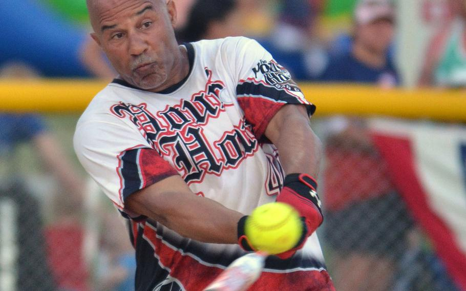 Lawrence Occomy of Pour House connects against American Legion during Saturday's Game 2 of a two-game men's final in the Firecracker Shootout Softball Tournament. Pour House won 13-12 for its second Firecracker title in three years, after Legion had forced the second game by winning the first final contest 9-4.