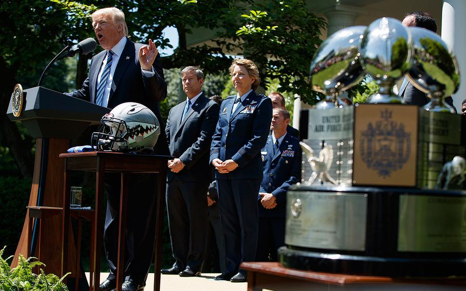 President Donald Trump speaks during a ceremony to present the Commander-in-Chief trophy to the Air Force Academy football team on Tuesday, May 2, 2017 in the Rose Garden of the White House.