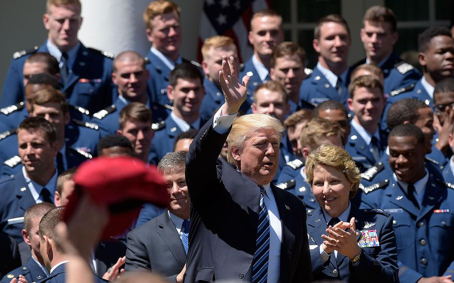 President Donald Trump waves to the audience after a ceremony in the Rose Garden of the White House in Washington, Tuesday, May 2, 2017, to present the Commander-in-Chief trophy to the Air Force Academy football team.