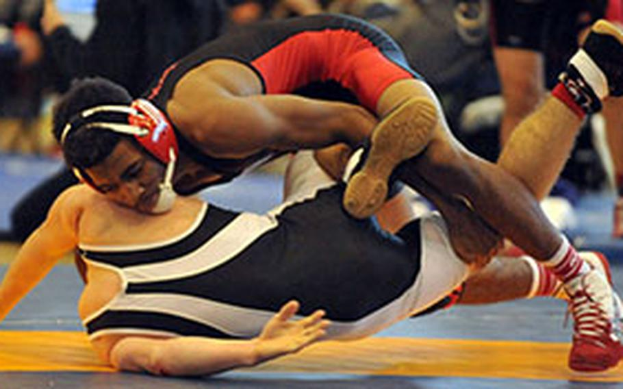 """Nile C. Kinnick 129-pounder Devoney Stanley tries to turn Zama's Carter Whitton during the title bout in last year's """"Beast of the Far East"""" wrestling tournament. Stanley pinned Whitton for the title. Stanley is one of three returninig """"Bezst"""" champions and one of six returning Far East champions entered in this week's """"Beast."""""""