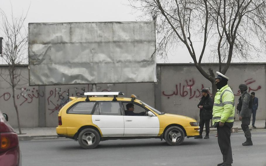 Traffic police were out in force in Kabul on Sunday, Jan. 28, 2018, the day after one of the deadliest bombings in the country since 2001. The suicide bombing, which used an ambulance laden with explosives in an area teeming with people, killed more than 100 and injured more than 200 near the old Interior Ministry building.