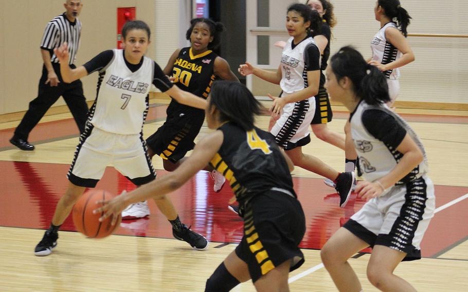 Kadena's Rhamsey Wyche drives up court toward American School of Bangkok's hanique Lucas (7) and Wyche's teammate Atirria Simms (30) during Tuesday's final in the Far East Girls Division I Basketball Tournament. The Eagles repeated their title of a year ago, beating the Panthers 44-35.