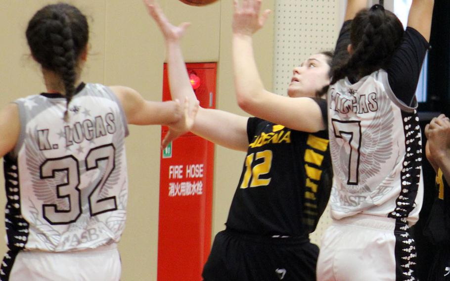 Kadena's Madison Shepard has trouble corraling the ball between American School of Bangkok's Keisharna and Shanique Lucas during Tuesday's final in the Far East Girls Division I Basketball Tournament. The Eagles repeated their title of a year ago, beating the Panthers 44-35.