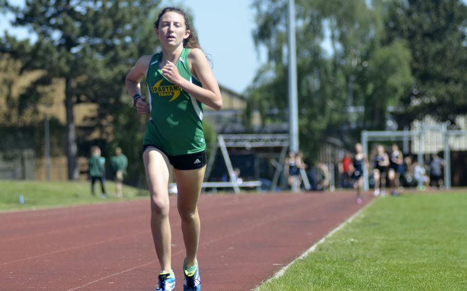 SHAPE distance standout Holly Moser finishes the final lap in the 1,600-meter run during a high school track meet at RAF Lakenheath, England, Saturday, May 19, 2018. Moser earned winning times of 5 minutes, 31 seconds in the 1,600 and 11:56 in the 3,200.