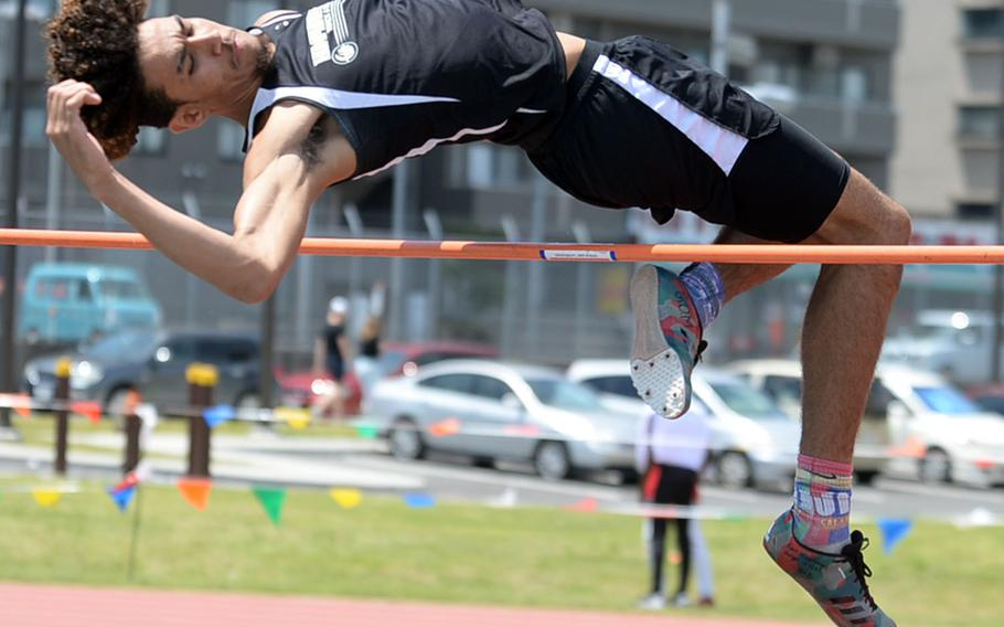 Humphreys' Quintin Metcalf clears the bar at 1.85 meters during Monday's high jump final in the Far East track and field meet. Metcalf won the Division II title.