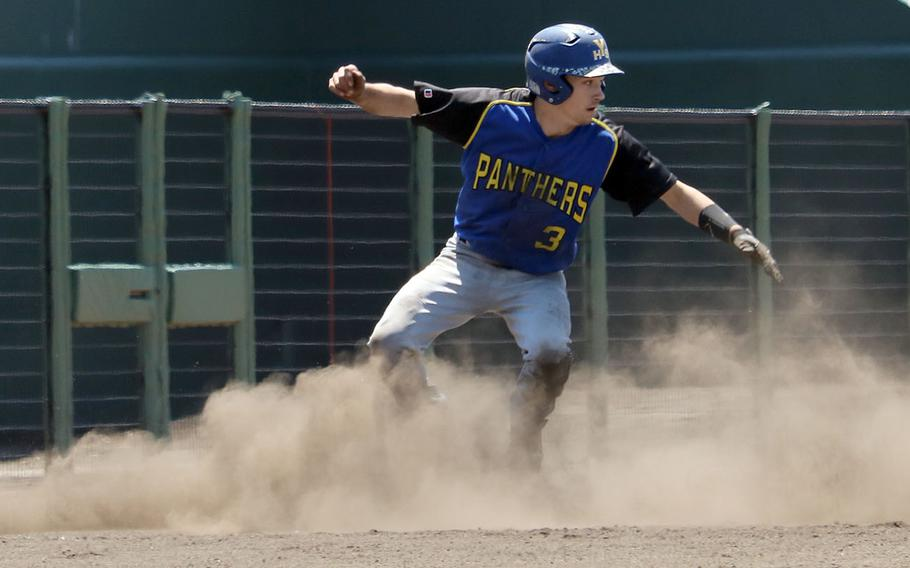 Yokota's Nick Yingling raises a cloud of dust coming around third base during Monday's double-elimination playoff game in the Far East Division II baseball tournament. The Panthers blanked Osan 11-0 as Troy Barnes threw a no-hitter.