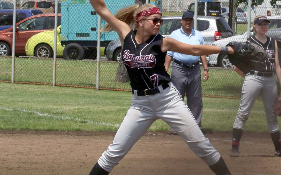 Matthew C. Perry's Hailey Greulich delivers against Osan during Monday's round-robin game in the Far East Division II softball tournament. The Samurai won 2-1.