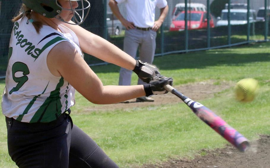 Kubasaki's Madison Richardson smacks the ball during Monday's round-robin play in the Far East Division I softball tournament. The Dragons won all three round-robin games and outscored their opponents 40-0.