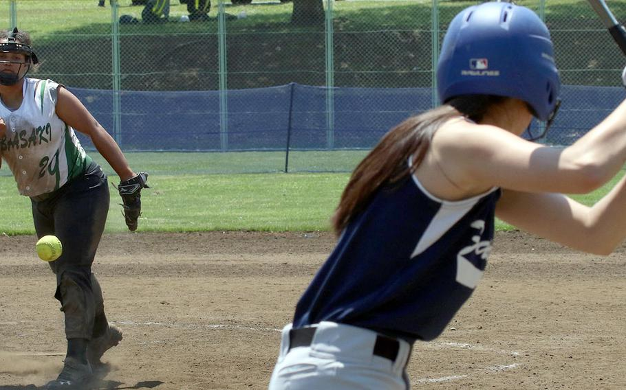 Kubasaki right-hander Makayla Major delivers against Seoul American during Monday's round-robin game in the Far East Division I softball tournament. The Dragons won all three round-robin games and outscored their foes 40-0.
