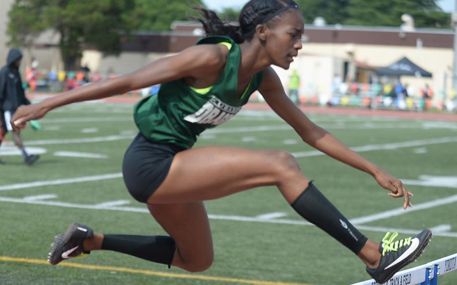 Kubasaki senior Ja'Tavia Callier clears the hurdles en route to breaking the Pacific and Far East meet records in the 100 hurdles Monday in the Far East track and field meet.