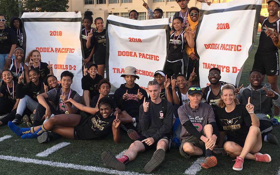 Humphreys track and field athletes celebrate the first sweep of Far East Division II banners in school history.