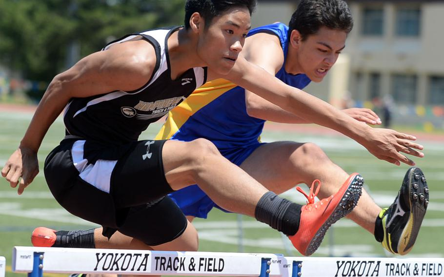 Humphreys' Cullen Areniego and St. Mary's Toki Schafer charge toward the finish line in the Far East meet 110-meter hurdles. They each won their respective division titles.