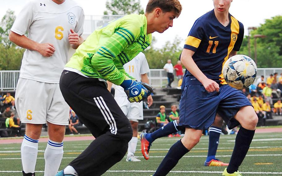 Yokota goalkeeper Renyck Robertson lunges for the ball against Christian Academy Japan during Wednesday's Far East Division II boys soccer tournament final. The Knights won 7-0 for the second straight year over Yokota.