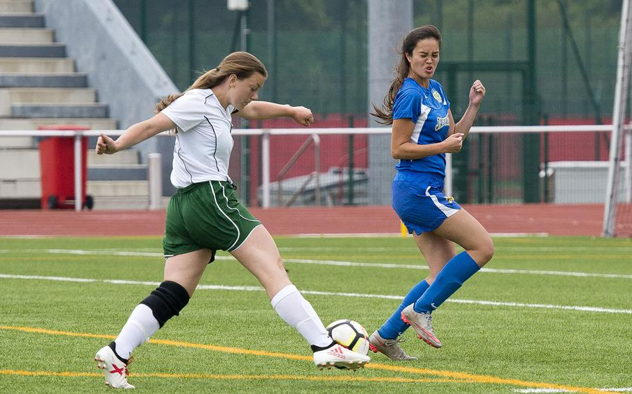 Alconbury's Laela Evans, left, shoots the ball past Sigonella's Kristiana Wyrick during the DODEA-Europe Division III soccer championship in Kaiserslautern, Germany, on Thursday, May 24, 2018.