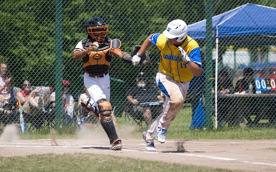 Sigonella's Alex Ogletree, right, runs to first with Spangdhalem's Deon Montgomery close behind during the DODEA-Europe Division II/III baseball championship at Ramstein Air Base, Germany, on Saturday, May 26, 2018.