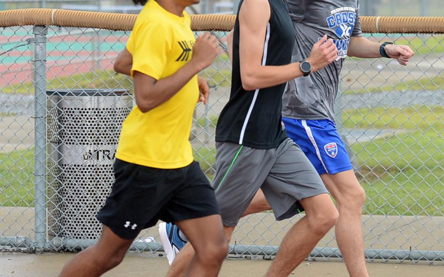 Juniors Devyn Lewis and Timothy Kilburn and senior Daniel McIntosh, a transfer from Seoul American, are among the largest cross country team in Humphreys' six years as a school.