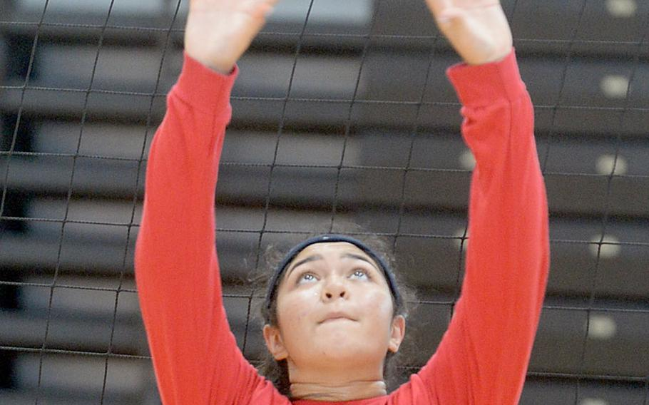Junior Tori Osterbrink works on setting during Nile C. Kinnick volleyball practice. The Red Devils must replace departed three-year starting setter Faith Hughes.
