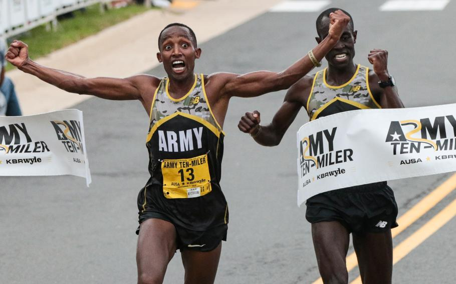 Spc. Frankline Tonui crosses the finish line ahead of Army Sgt. Evans Kirwa, taking first place at the 2018 Army Ten-Miler held in Washington, D.C., on Sunday, Oct. 7, 2018.
