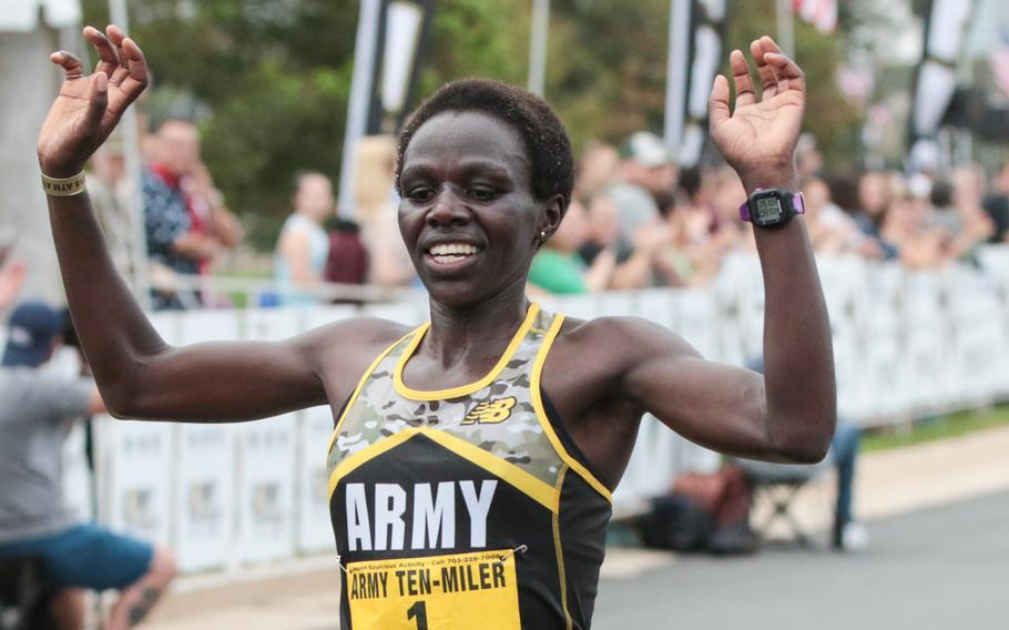 Spc. Susan Tanui celebrates after becoming the first woman to cross the finish line at the 2018 Army Ten-Miler held in Washington, D.C., on Sunday, Oct. 7, 2018.