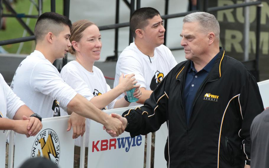 Army Chief of Staff Gen. Mark Milley shakes hands with soldiers at the finish line of the 2018 Army Ten-Miler held in Washington, D.C., on Sunday, Oct. 7, 2018.