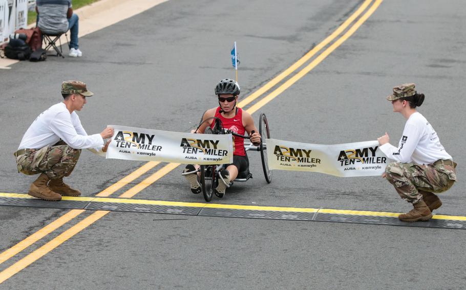 Tisha Knickerbocker crosses the finish line at the 2018 Army Ten-Miler held in Washington, D.C., on Sunday, Oct. 7, 2018.