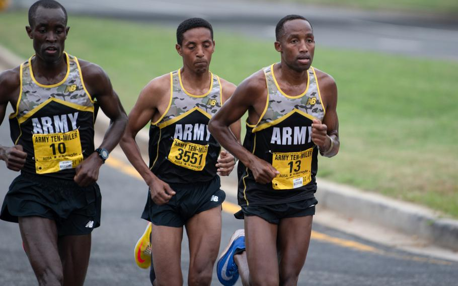 Evans Kirwa, far left, Girma Mecheso, center, and Frankline Tonui (who placed second, third and first respectively) shortly before the Mile 4 marker during the Army Ten-Miler.