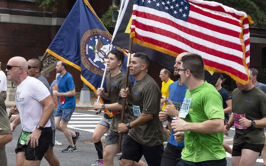 Soldiers carry the colors during the Army Ten-Miler in Washington, D.C., Oct. 7, 2018.
