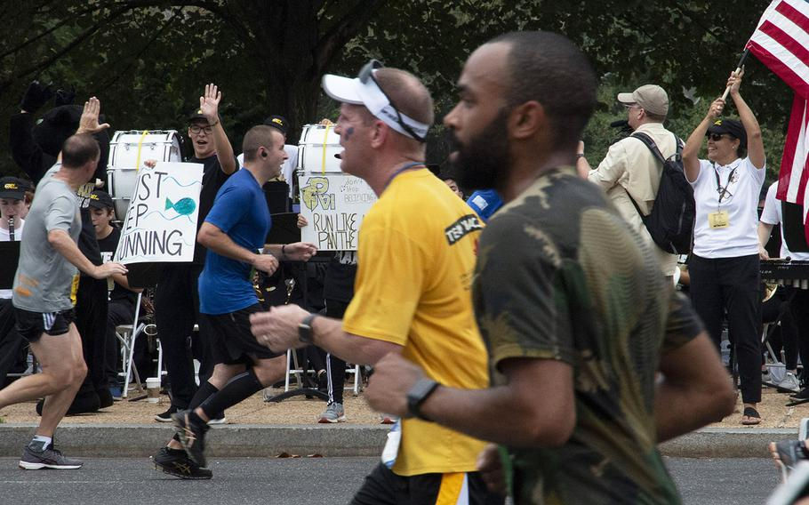 Band members from Pope Paul VI High School in Fairfax, Va., cheer on the runners during the Army Ten-Miler in Washington, D.C., Oct. 7, 2018.