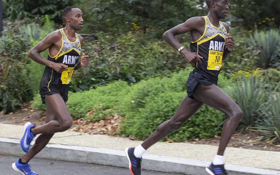 Eventual winner Frankline Tonui trails fellow World Class Athlete Program runner Evans Kirwa, who would go on to finish second, near the six-mile mark of the Army Ten-Miler in Washington, D.C., Oct. 7, 2018.