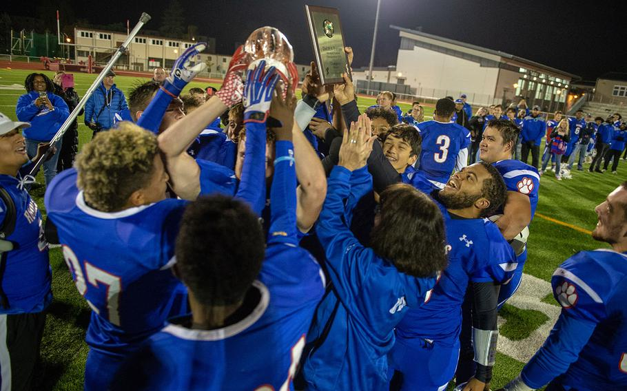 The Ramstein Royals celebrated after being crowned the DODEA-Europe Division I football champions after playing the Lakenheath Lancers in a game, Saturday, Nov. 3, 2018.