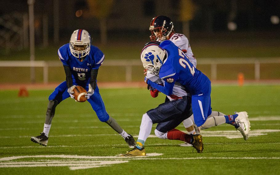 Miguel Smith of Ramstein picks up a fumbled punt return during the DODEA-Europe Division I football championship game between the Ramstein Royals and the Lakenheath Lancers, Saturday, Nov. 3, 2018.