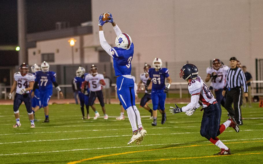 Naser Eaves of Ramstein intercepts a pass during the DODEA-Europe Division I football championship game between the Ramstein Royals and the Lakenheath Lancers, Saturday, Nov. 3, 2018.