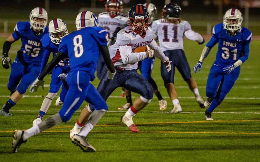 Ion Duenas of Lakenheath tries to avoid a tackle during the DODEA-Europe Division I football championship game between the Ramstein Royals and the Lakenheath Lancers, Saturday, Nov. 3, 2018.