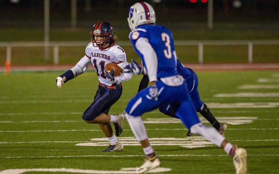 Ethan Smith of Lakenheath runs for a first down during the DODEA-Europe Division I football championship game between the Ramstein Royals and the Lakenheath Lancers, Saturday, Nov. 3, 2018.