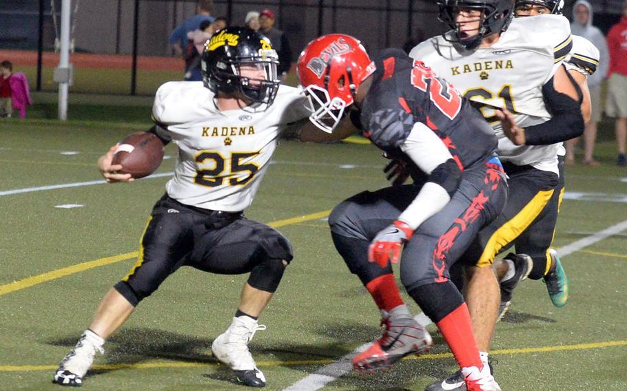 Kadena quarterback Wyatt Knopp tries to run around Kinnick defender Marcus Marion.