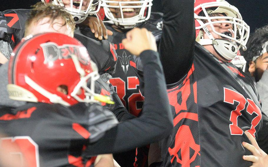 Nile C. Kinnick players celebrate their first Far East Division I football title.