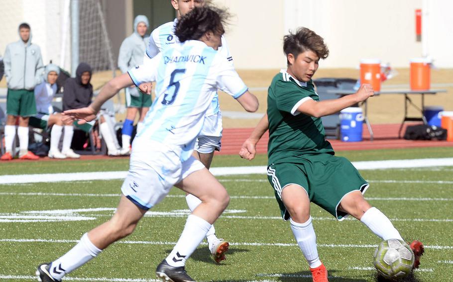 Kubasaki's Kaisei Taylor sends the ball past Chadwick's Troy Dillon.