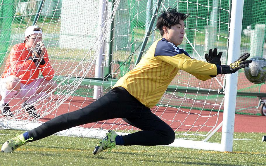 Chadwick keeper Mitchell Masuda makes a stop on a penalty kick during Saturday's shootout in the Perry Cup final against Kubasaki. The Dolphins won in penalties 3-1.