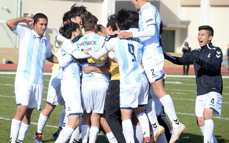 Chadwick International soccer players celebrate following their PK shootout win in Saturday's Perry Cup final over Kubasaki.
