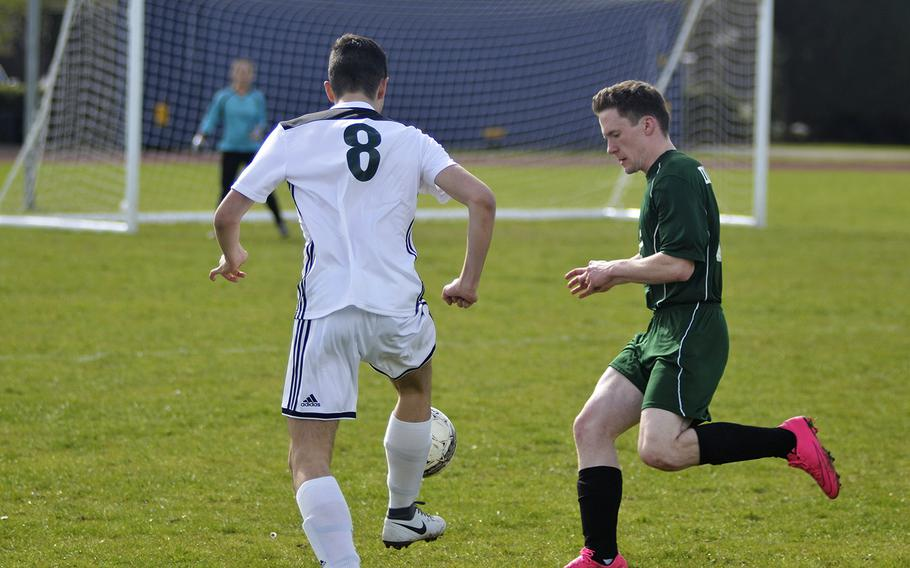 SHAPE player Domingo Jarillo races Alconbury's Jason Sanders to the goal during a high school soccer game at RAF Alconbury, England, Saturday, March 23, 2019. Jarillo had one goal in the 7-0 win against the Dragons.